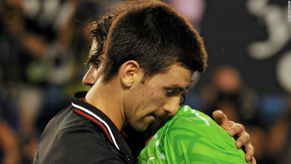 Rivals Novak Djokovic and Rafael Nadal embrace during the final of the Australian Open in Melbourne on January 30 this year. The match was the longest in grand slam history at five hours and 53 minutes. Djokovic won 5-7 6-4 6-2 6-7 7-5.