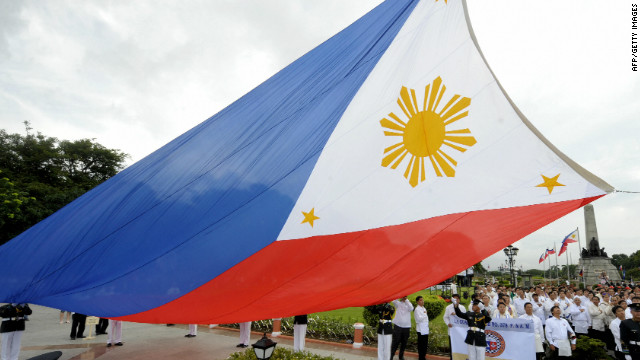 Government officials lead a flag-raising ceremony at Manila's Luneta park on June 12, 2009, to celebrate the 111th anniversary of the declaration of Philippine independence from Spanish rule. The day was marked with job fairs and other programmes to emphasise the efforts to alleviate the effects of the world financial turmoil. AFP PHOTO / JAY DIRECTO (Photo credit should read JAY DIRECTO/AFP/Getty Images)