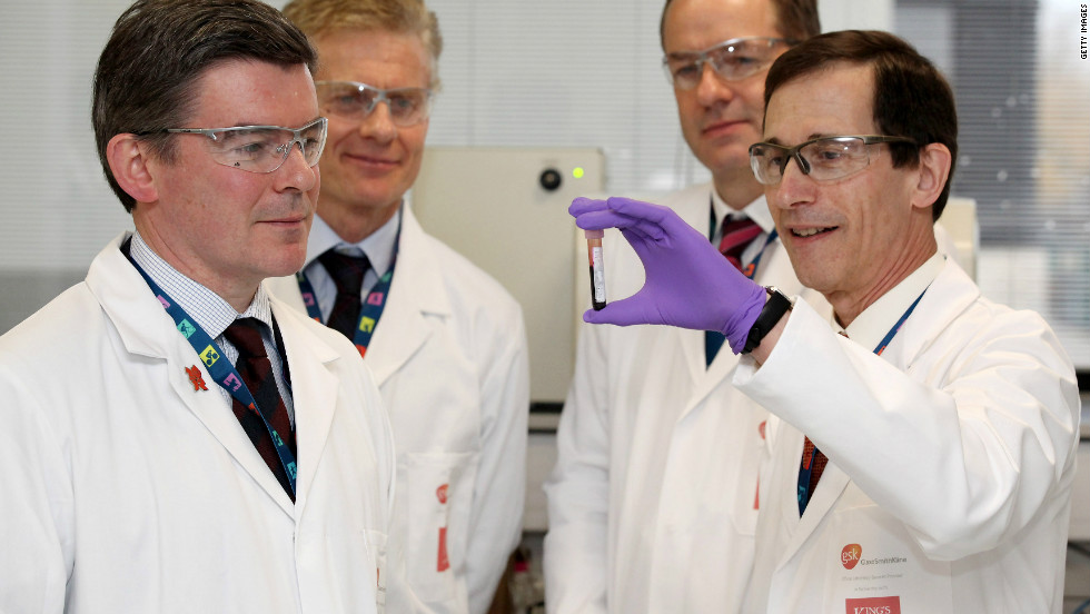 Professor David Cowan (right), head of the London 2012 lab, shows UK Olympics minister Hugh Robertson around the drug-testing facility in east London.