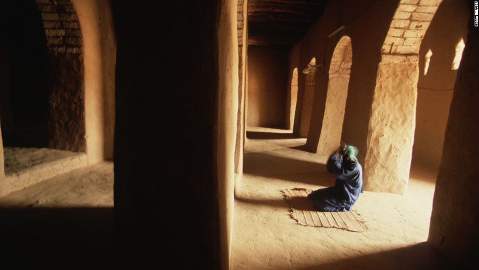A man prays inside the Sankore mosque in Timbuktu. Part of the madrasah was commissioned by Mansa Musa I.
