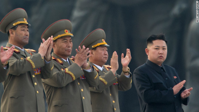 North Korean leader Kim Jong-Un (R) claps during a ceremony in Pyongyang on April 13, 2012