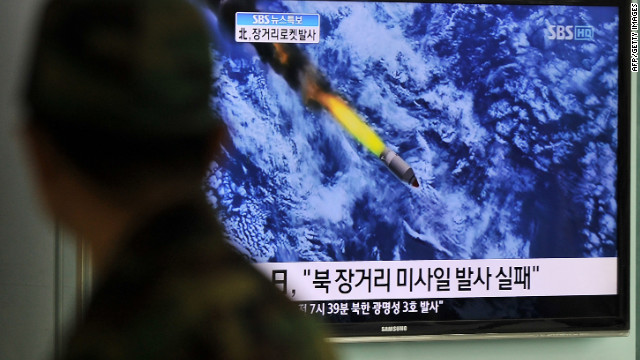 South Korean people watch a TV screen showing a graphic of North Korea's rocket launch, at a train station in Seoul on April 13, 2012.