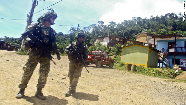 Peruvian soldiers patrol the town of Kepashiato in the Echarate district on April 9, 2012.
