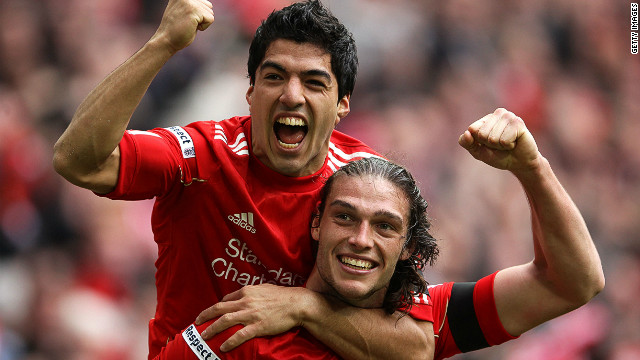 Liverpool's Andy Carroll (r) celebrates with Luis Suarez after scoring the winning goal against Everton in the FA Cup semifinal