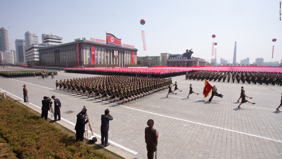 "North Korean soldiers march past the podium during the parade in Pyongyang on Sunday.  Elaborate and extensive 100th anniversary celebrations of Kim Il Sung's birth have been in the works for years. Grandson Kim Jong Un is now North Korea's ""supreme commander"" -- a title he has recently assumed, following the death of his father, Kim Jong Il."