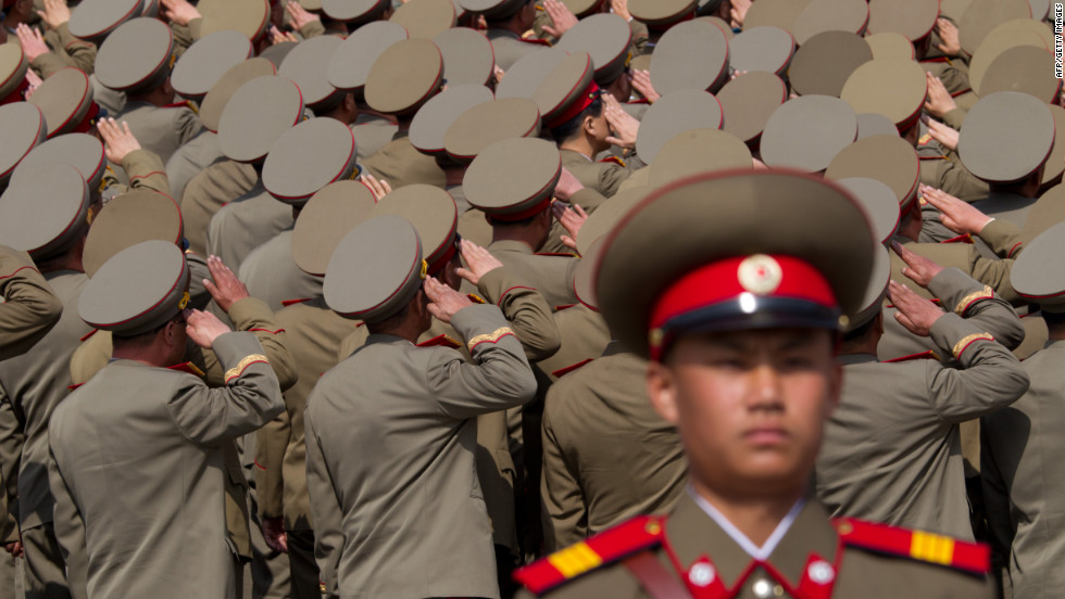 North Korean soldiers salute during Sunday's military parade.