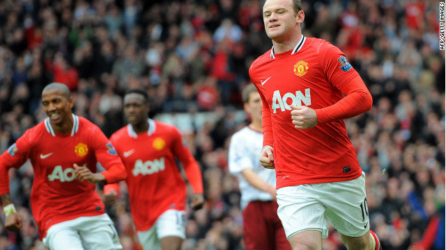 Wayne Rooney celebrates his opening goal from the penalty spot at Old Trafford.