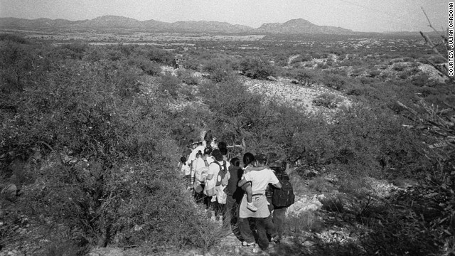People crossing the border in Sasabe, Arizona. A large number of immigrants cross the border in this mountainous area that has become the perferred spot to cross into the US.