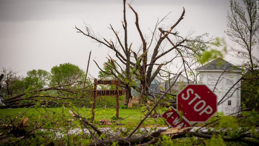 The streets are littered with  trees and debris  after the aparent tornado struck Thurman. Officials evacuated the entire population  of the town -- roughly 300 people. The storm destroyed three out of every four homes in Thurman.