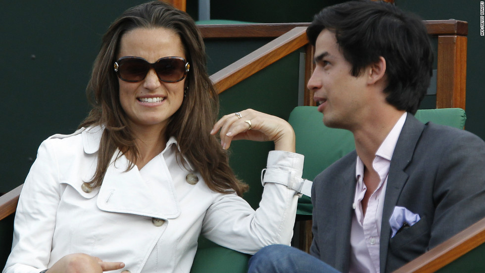 Pippa Middleton and a friend watch a match at the French Open tennis championship at the Roland Garros stadium, on May 30, 2011.
