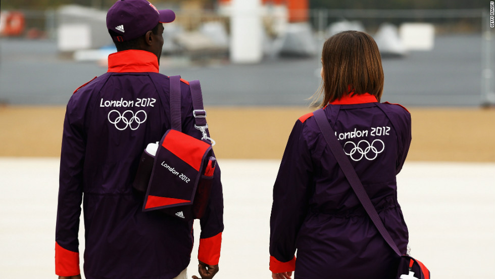 Models wear the Volunteers Uniform for London 2012 at a photocall at the Olympic Park on November 22, 2011.