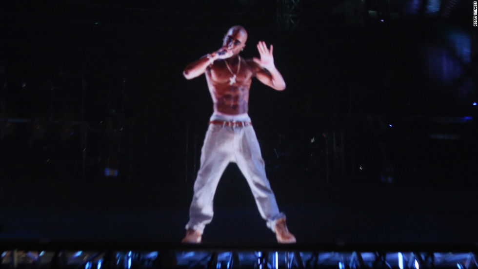 "Tupac Shakur still has it. The rapper, who died at age 25 in 1996, entertained audiences via hologram at Coachella on Sunday. Pac's eerily realistic performance has some fans tweeting that, even in death, the ""Hail Mary"" rapper is a better entertainer than present day artists. Here are some other hologram performances we'd like to see:"