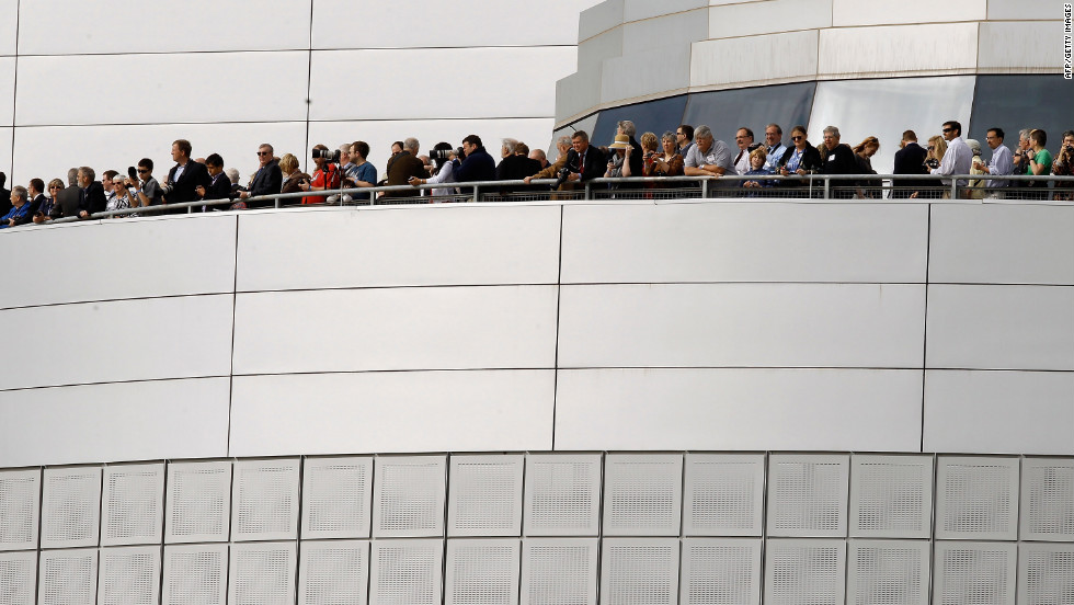 Special guests watch the Discovery's arrival from the observation deck of the Smithsonian National Air and Space Museum Steven F. Udvar-Hazy Center on Tuesday in Chantilly.