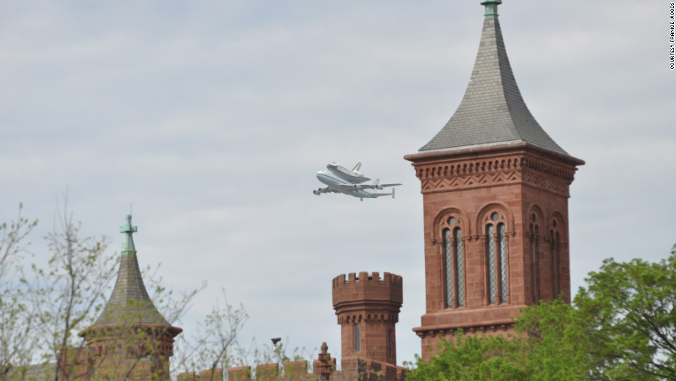 The shuttle will officially become part of the Smithsonian's collection at a ceremony on April 19 at the air and space museum's Udvar-Hazy Center in Chantilly, Virginia. Here, the shuttle flies past the Smithsonian castle on the National Mall.