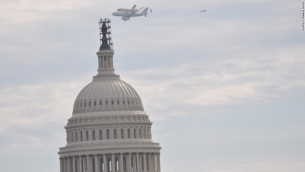 Discovery flies over the Capitol in Washington. It made several passes over the National Mall, drawing cheers from the crowds that gathered to watch it.