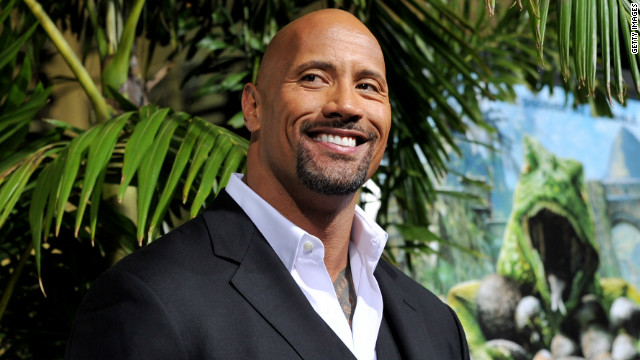"Dwayne ""The Rock"" Johnson arrives at the premiere of 'Journey 2: The Mysterious Island' at the Chinese Theater in February 2012 in Los Angeles, California"