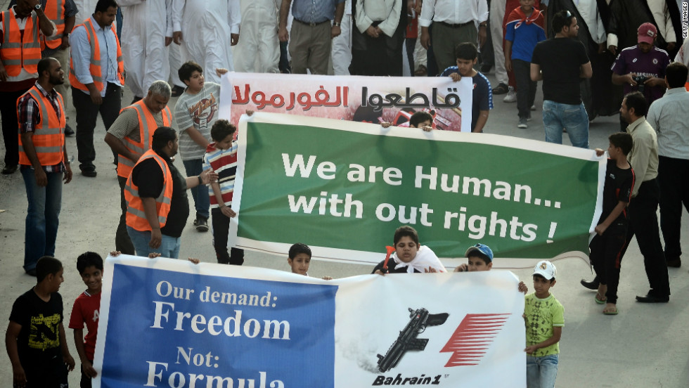 Bahraini Shiite Muslims in the town of Muharraq take part in a demonstration calling for the cancelation of Sunday's race.