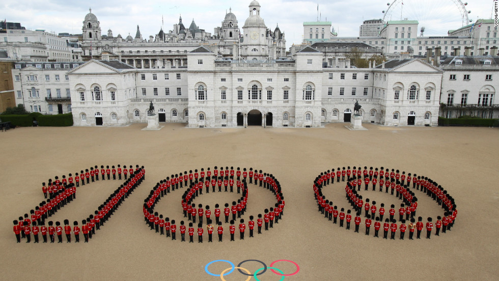 More than 250 Guardsmen mark 100 days until the London 2012 Olympics starts on on July 27.  They are at Horse Guards Parade in central London, which will host beach volleyball.