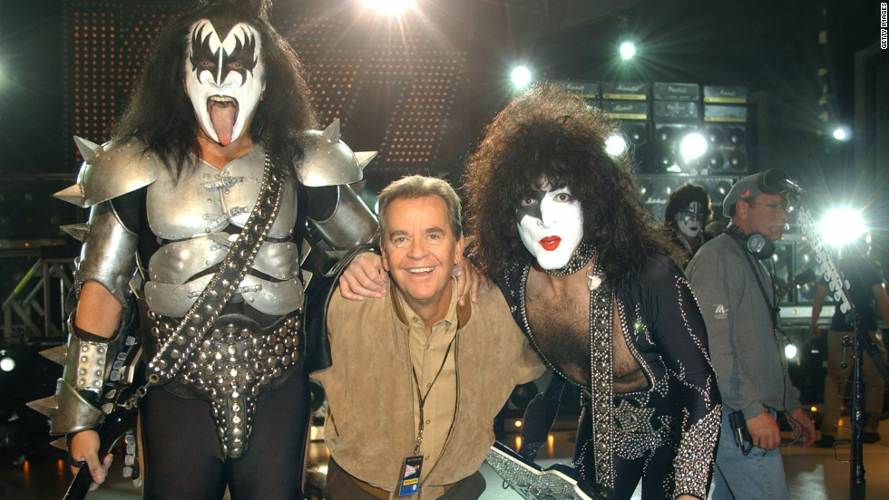 "Clark poses with Gene Simmons and Paul Stanely during the taping of the 50th anniversary special of ""American Bandstand."""