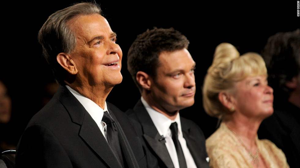 Clark, Ryan Seacrest and Kari Clark attend the Emmy Awards in 2010.