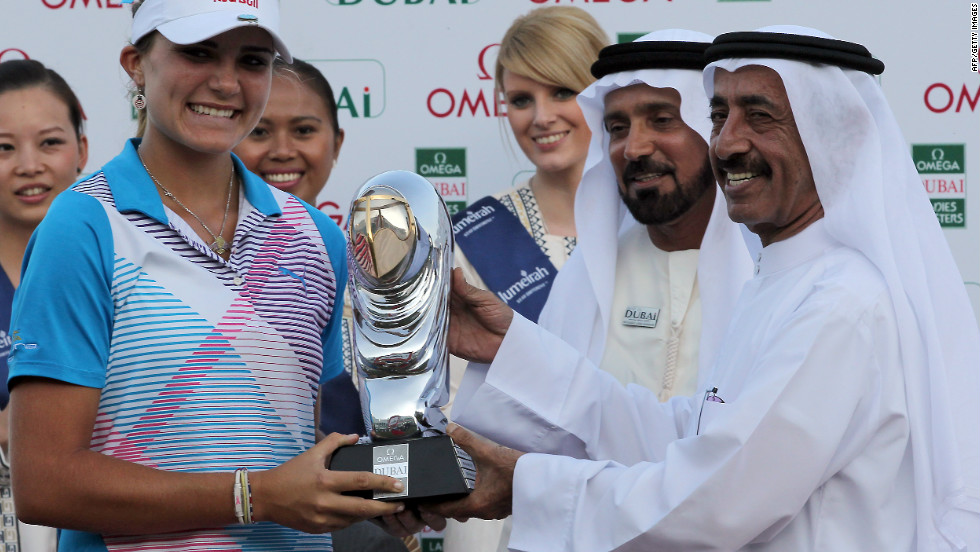 Thompson is the youngest player to win on the European Ladies' Tour. Here she receives her trophy at the Dubai Ladies Masters on December 17, 2011.