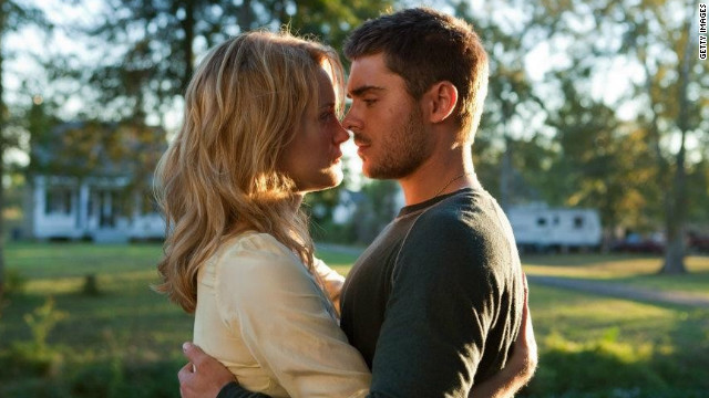 "Taylor Schilling and Zac Efron star in ""The Lucky One."""