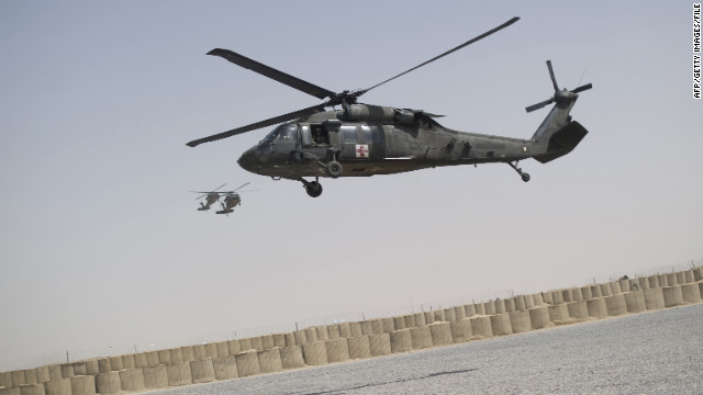 A UH-60 Black Hawk medevac helicopter of 159th Brigade Task Force Thunder lands at FOB Pasab in Kandahar province on August 22, 2011. Afghanistan is gripped in an insurgency that has increased every passing year since it was launched by the remnants of the Taliban in late 2001 when their regime was toppled in a US-led invasion. AFP PHOTO/Johannes EISELE (Photo credit should read JOHANNES EISELE/AFP/Getty Images)