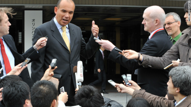 Michael Woodford (top,C), former Olympus president and chief executive officer who was dismissed from his posts last October, speaks to reporters upon his arrival at an extraordinary shareholders meeting in Tokyo on April 20, 2012.