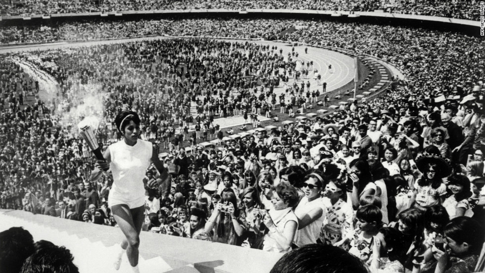 The 1968 Mexico Olympics began in controversial fashion. Revolution -- from Cuba to China -- was spreading across the world.