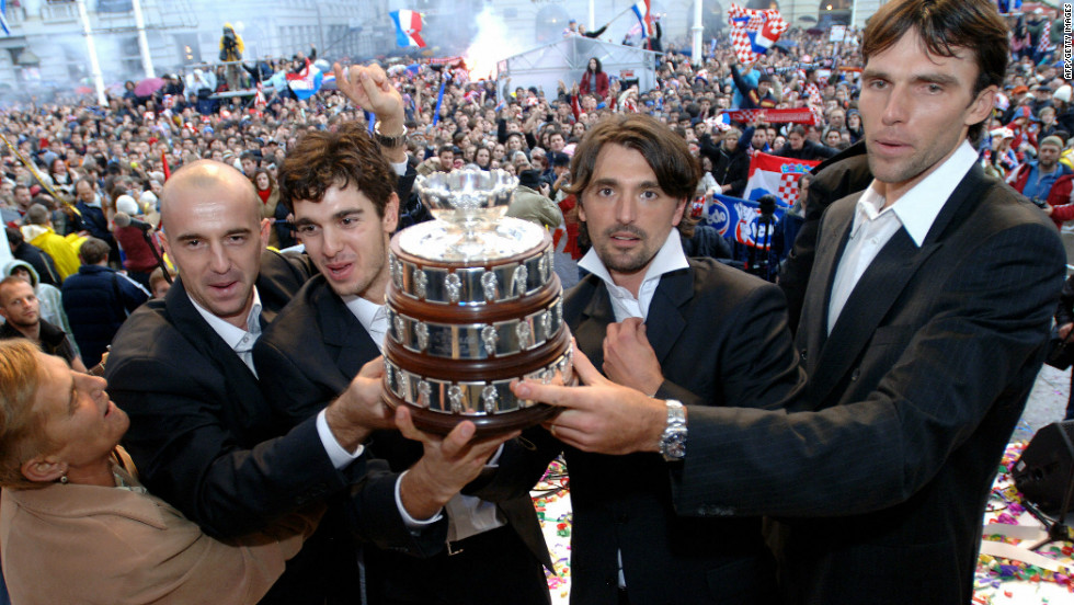 The victorious team parade a replica Davis Cup trophy in the main square in Zagreb.