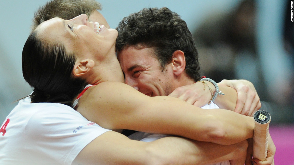 World No. 17 Jelena Jankovic, left, celebrates with her teammates after beating Russia's Svetlana Kuznetsova to put Serbia in to the Fed Cup final for the first time.