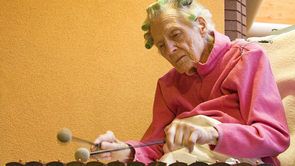 Janette, an ex-attorney, enjoyed playing xylophone while at hospice in the United States during the final days of her life.