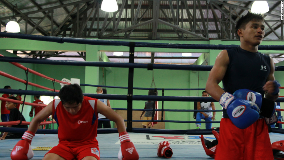 Members of the Philippine youth amateur boxing team take a break after sparring.