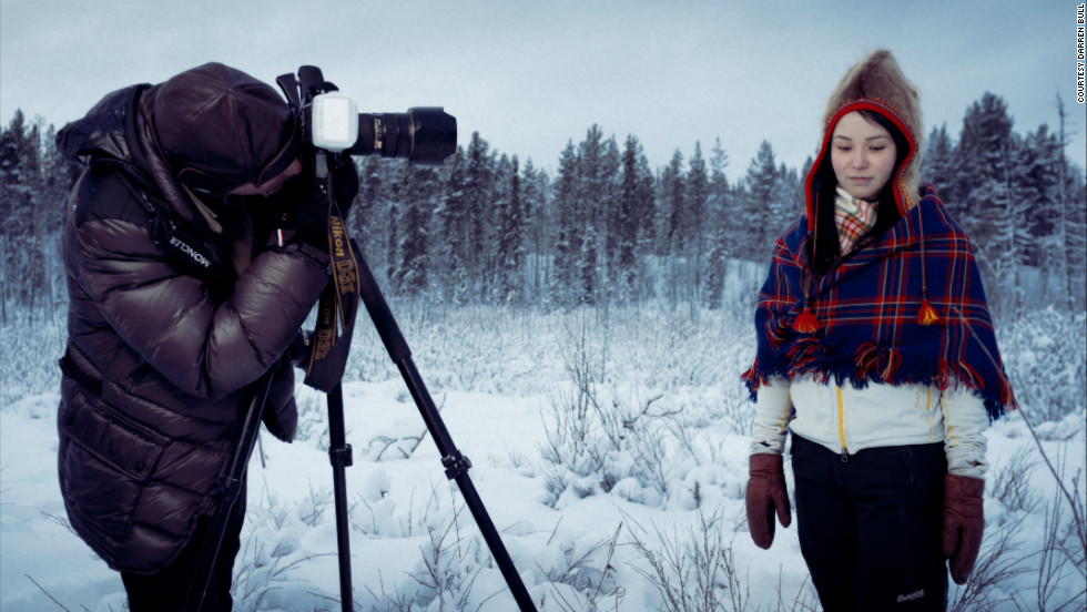Moukarzel takes a picture of a local Sami girl, against the dark, ethereal backdrop of the Lulea forest.