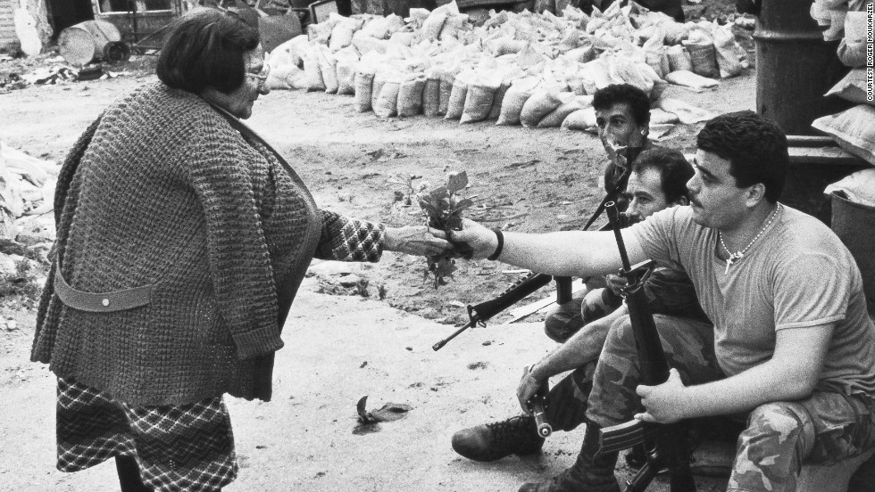 "He says he has always been primarily interested in taking pictures of people and ""capturing moments of humanity"" -- such as this striking exchange from 1978 between a Lebanese soldier and a woman in war-torn Beirut."