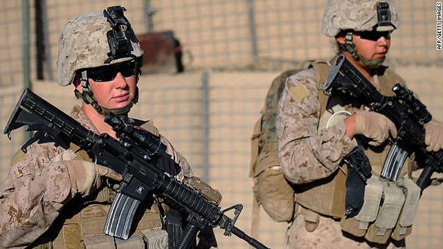 US Marine Corporal Jessica L. Williams (L) and Lance Corporal Shawnee Redbear of 2nd Battalion, 1st Marines Golf Company patrol in Basabad, Helmand Province, on March 9, 2011. The US Marines deployed about 40 Female Marines in Helmand province and Nimruz for the Female Engagement Team (FET) programme to interact with Afghan civilians, specifically women and children. AFP PHOTO / ADEK BERRY (Photo credit should read ADEK BERRY/AFP/Getty Images)