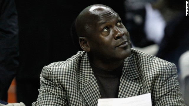 Charlotte Bobcats owner, Michael Jordan sits beside fiance, Yvette Prieto during the Golden State Warriors versus Charlotte Bobcats game at Time Warner Cable Arena on January 14, 2012 in Charlotte, North Carolina.