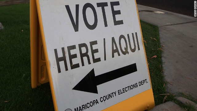 A bilingual sign announcing a polling place in Phoenix in 2008. Latino voters are the fastest growing electorate in the country.