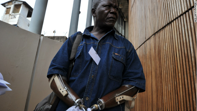 Sierra Leonian amputee association chairman Alhaji Jusu Jarka walks outside the Special Court in Freetown on April 26, 2012.