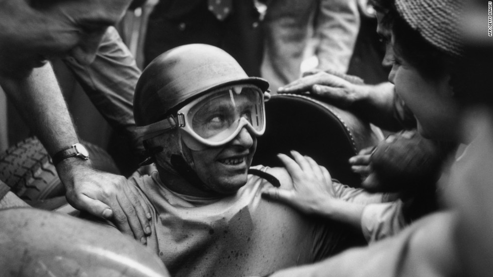 Fangio is mobbed by fans after winning the 1955 Italian Grand Prix. The racing legend had 24 wins and five world championships in a career spanning almost 20 years.