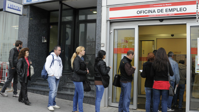 People wait in line at a government employment office in Madrid in April 2012.