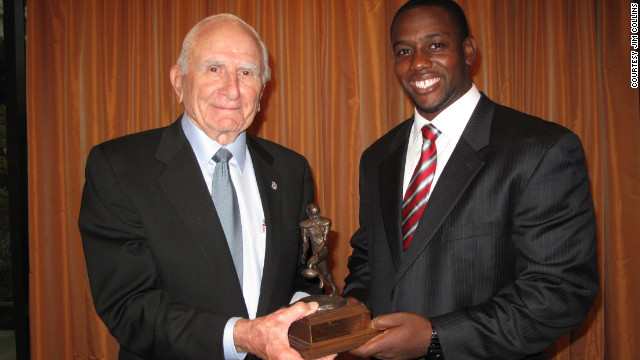 Salata presents the Houston Texans' Cheta Ozougwu with the 2011 honor last year.