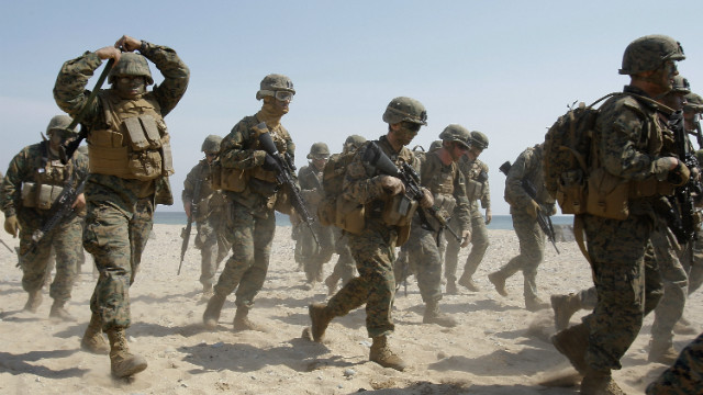 About 9,000 U.S. Marines will be transferred off the Japanese island of Okinawa under a new deal by U.S. and Japanese officials.