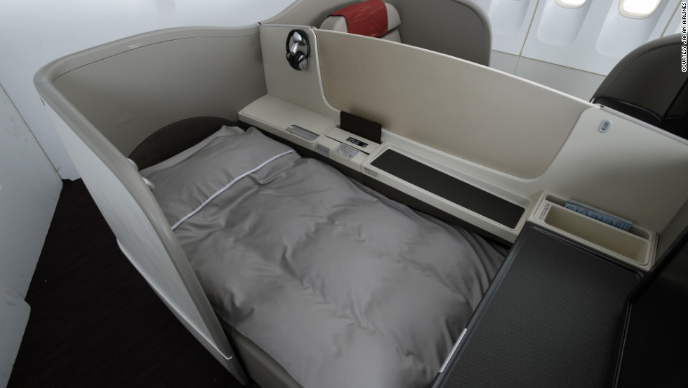 Leather seats are comfortably designed, oversized lap trays are height-adjustable and ottomans double as optional guest seating on Japan Airlines.