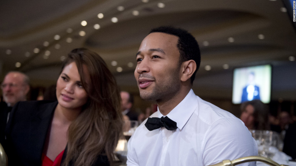 Singer John Legend listens to a speaker at the the correspondents' dinner.