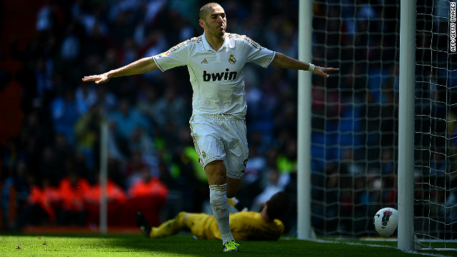 French international Karim Benzema celebrates scoring Real Madrid's second goal in a 3-0 win against Sevilla on Saturday