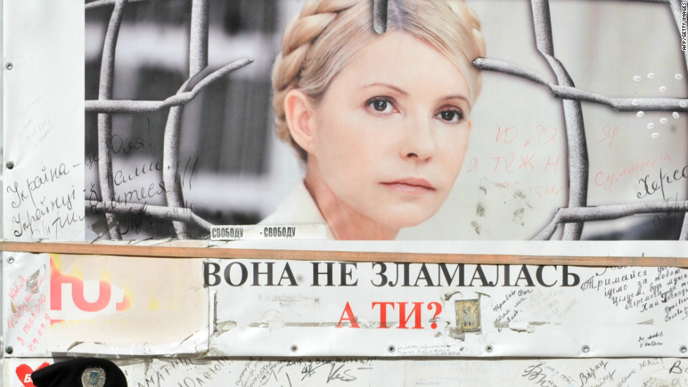 A police guard stands outside Tymoshenko's cell at the Kachanivska prison in Kharkiv. Her supporters have called on president Victor Yanukovych to quit in the wake of allegations of abuse.