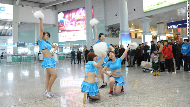 "China's Dalian International Airport aims to ""demonstrate spirit"" with its squad of cheerleaders."