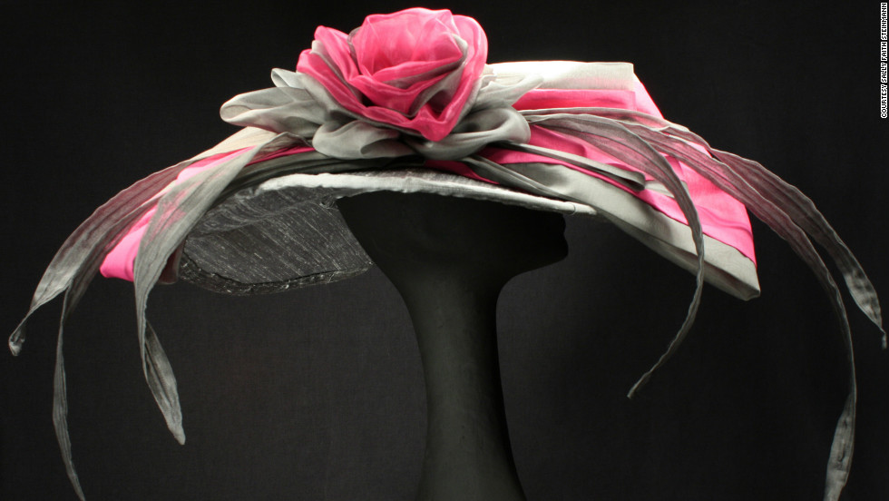 "Steinmann's ""Michaela"" hat uses dupioni silk to create a wide brim hat, as well as a large rose curl, and one of her trademarks, several silk organza ""feathers."" She doesn't like to use real feathers."