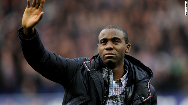 Fabrice Muamba waves to the crowd during his emotional appearance at the Reebok before Bolton's game against Tottenham.
